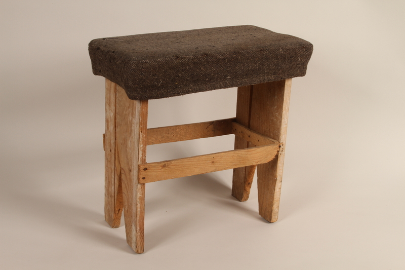 1989.273.3 front Stool made by refugees from old wooden crates during the war