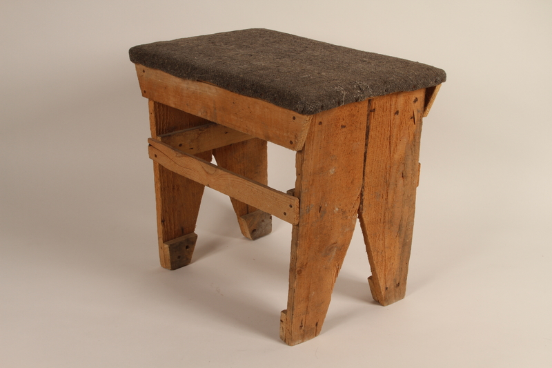 1989.273.4 front Stool made by refugees from old wooden crates during the war