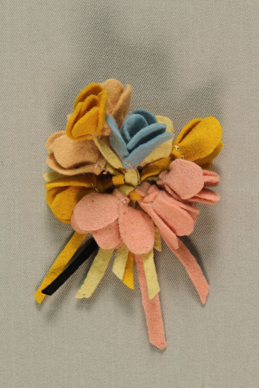 1989.273.7 front Corsage made by Jewish refugees
