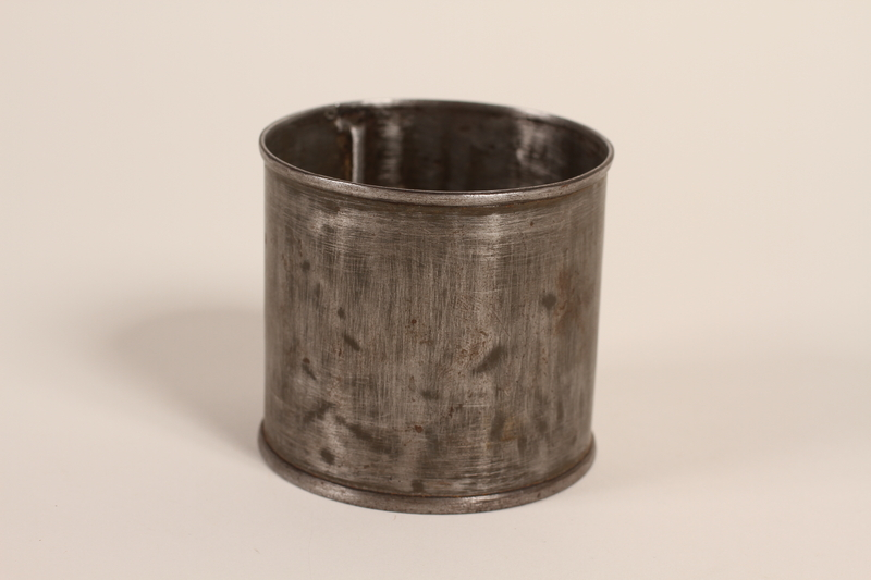 1995.46.1 front Tin can used as a cup