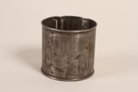 1995.46.1 front Tin can used as a cup  Click to enlarge