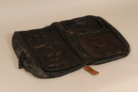 1995.50.1 front Garment bag retrieved from Dachau postliberation by a US soldier  Click to enlarge
