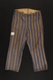Concentration camp uniform striped trousers worn by a Polish Jewish prisoner in several concentration camps