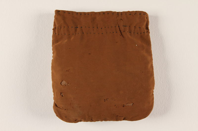 1995.60.1 front Brown tefillin pouch used by a Polish Jewish man in the Warsaw ghetto and in hiding