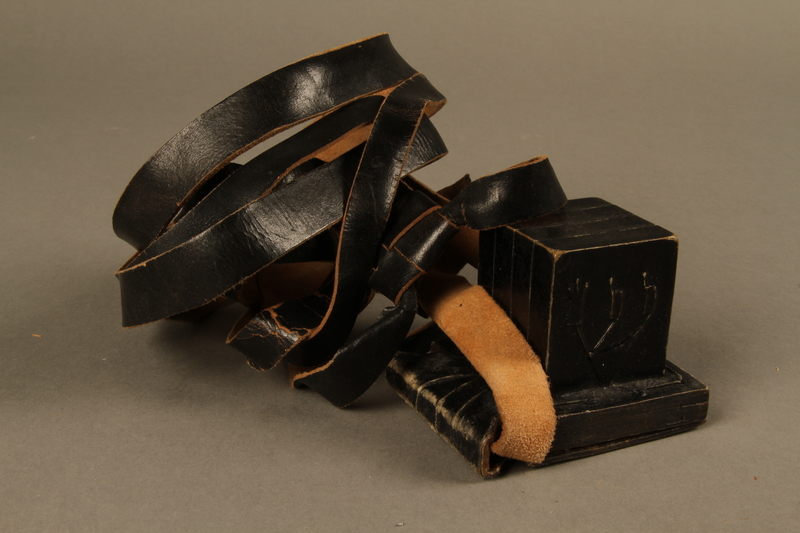 1995.60.2 front Head tefillin worn by a Polish Jewish man in the Warsaw ghetto and in hiding