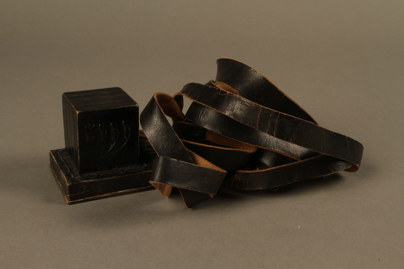 1995.60.2 back Head tefillin worn by a Polish Jewish man in the Warsaw ghetto and in hiding