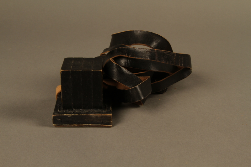 1995.60.2 left side Head tefillin worn by a Polish Jewish man in the Warsaw ghetto and in hiding