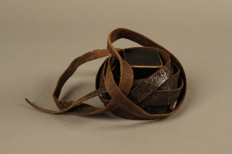 1995.60.3 front Hand tefillin worn by a Polish Jewish man in the Warsaw ghetto and in hiding