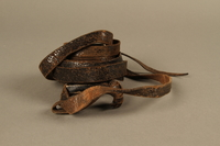 1995.60.3 back Hand tefillin worn by a Polish Jewish man in the Warsaw ghetto and in hiding  Click to enlarge