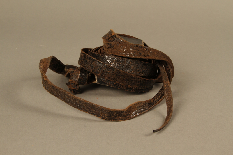 1995.60.3 right side Hand tefillin worn by a Polish Jewish man in the Warsaw ghetto and in hiding