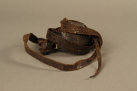 1995.60.3 right side Hand tefillin worn by a Polish Jewish man in the Warsaw ghetto and in hiding  Click to enlarge