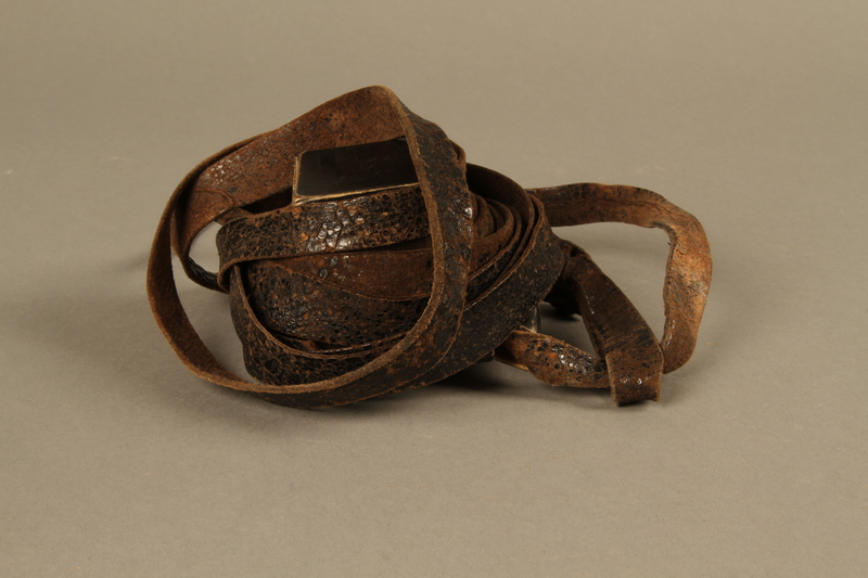 1995.60.3 left side Hand tefillin worn by a Polish Jewish man in the Warsaw ghetto and in hiding