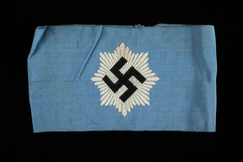 1995.62.4 front National Air Defense League armband with a swastika on a blue field