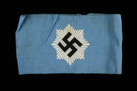 1995.62.4 front National Air Defense League armband with a swastika on a blue field  Click to enlarge