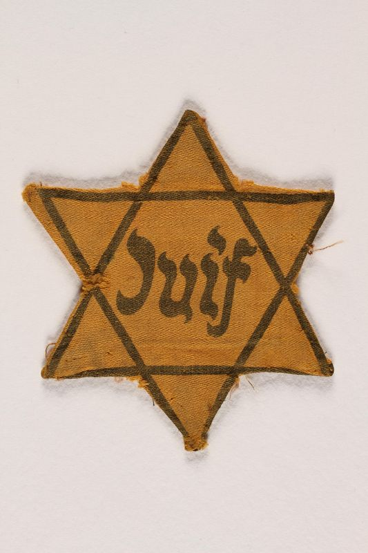 1995.7.1 front Star of David badge with Juif printed in the center