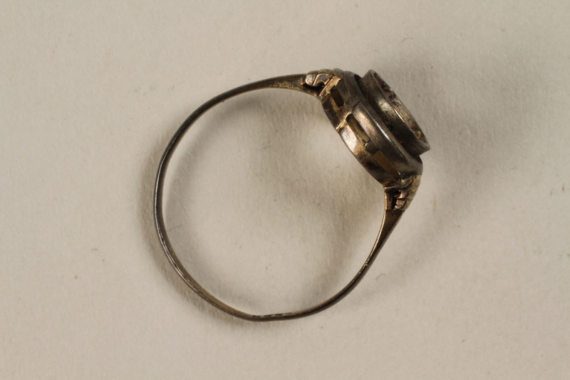 1995.72.1 side Gold ring taken by a Jewish youth when he escaped Treblinka death camp