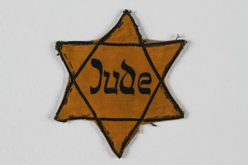 1995.78.10 front Star of David badge with Jude worn by a German Jewish man