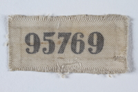 1995.78.6 front Prisoner ID badge number 95769 worn by a German Jewish man  Click to enlarge