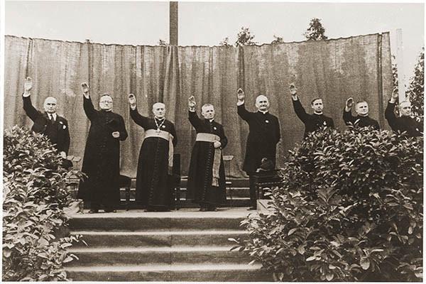 Roman Catholic clerics give the Nazi salute at the fifth Catholic youth rally <i>(Jugendtreffen)</i> in Berlin, 1933. <i>US Holocaust Memorial Museum, courtesy of bpk-Bildagentur</i>