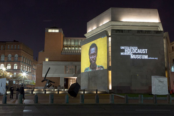 An image taken in Central African Republic by Michael Christopher Brown is projected onto the Museum's exterior walls during Our Walls Bear Witness in 2014. <i>US Holocaust Memorial Museum</i>