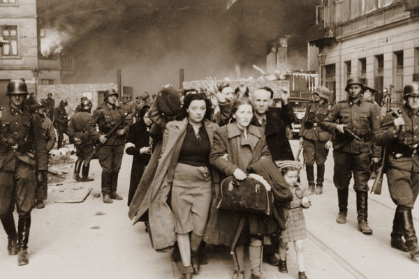 Jews are marched toward deportation during the Warsaw Ghetto Uprising in 1943. <i>National Archives and Records Administration</i>