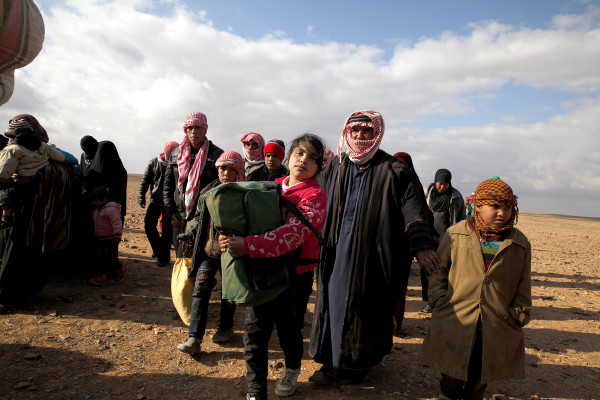 Refugees from Syria walk into Jordan at the Al Hadalat crossing on the far eastern border. <i>Lucian Perkins for the US Holocaust Memorial Museum</i>