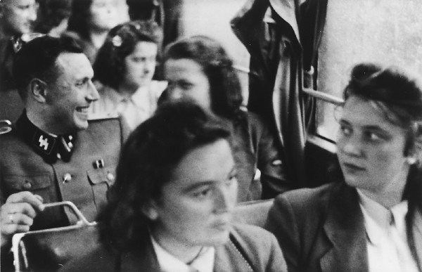 Young women in the SS Helferinnen arrive by bus at Solahütte, the SS retreat near Auschwitz. <i>US Holocaust Memorial Museum</i>
