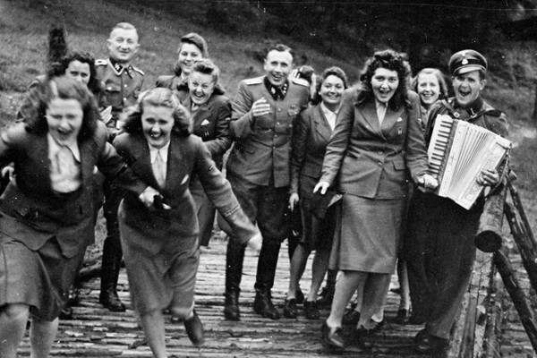 Nazi officers and female auxiliaries at a retreat near Auschwitz, 1944. <i>Höcker album, US Holocaust Memorial Museum</i>