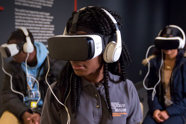 The Museum has experimented with using virtual reality to engage young people in special exhibitions. This student watches a 360-degree video of a Syrian refugee trying to establish a new life in Jordan as part of the exhibition <i>Genocide: The Threat Continues. US Holocaust Memorial Museum</i>