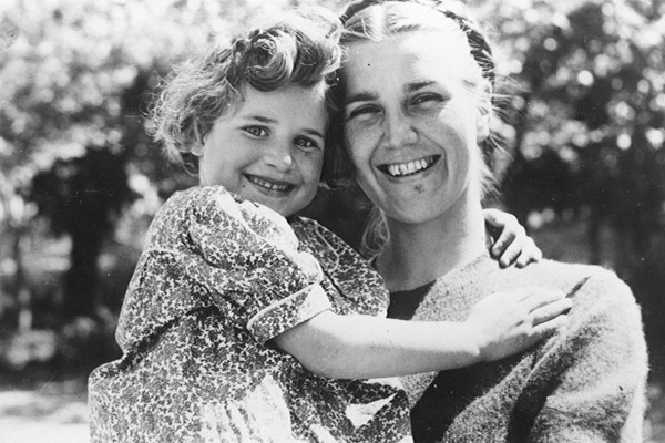 Marjorie McClelland, an American Quaker relief worker in Marseille, France, holds a Jewish refugee child named Toni in 1942, shortly before she left for the United States on a transport sponsored by the Joint Distribution Committee. <i>Courtesy of the American Jewish Joint Distribution Committee</i>
