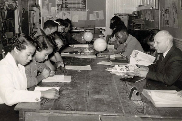 Professor Ernst Borinski, a refugee from Germany, teaches in the social science lab and Tougaloo College in Mississippi, circa 1960, where students were encouraged to think critically about social attitudes, prejudices, and race relations. <i>Ernst Borinski Papers, Tougaloo College Civil Rights Collection, Mississippi Department of Archives and History</i>