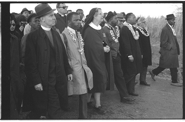 Community and religious leaders, including Rev. Dr. Martin Luther King, Jr. (third from right) and Rabbi Abraham Joshua Heschel (second from right), in the Selma to Montgomery march for voting rights, Alabama, 1965. <i>Copyright Dan Budnik</i>