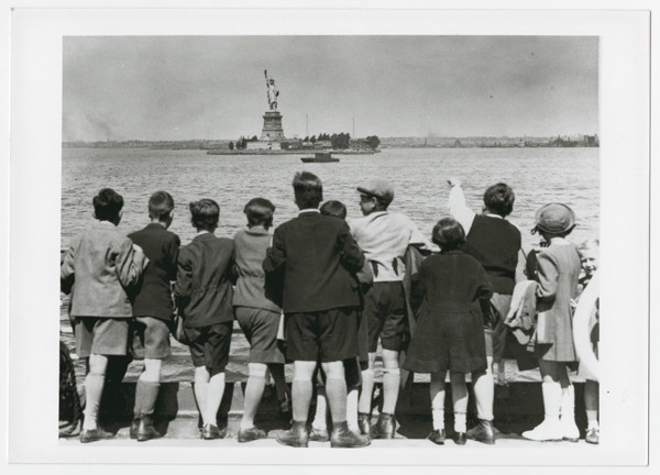 A group of Jewish children rescued from Vienna look at the Statue of Liberty as they pull into New York harbor in June 1939. <i>US Holocaust Memorial Museum, courtesy of Steven Pressman</i>