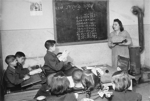 Students study math at the Zeilsheim displaced persons camp in Germany after World War II. <i>US Holocaust Memorial Museum, courtesy of Alice Lev</i>