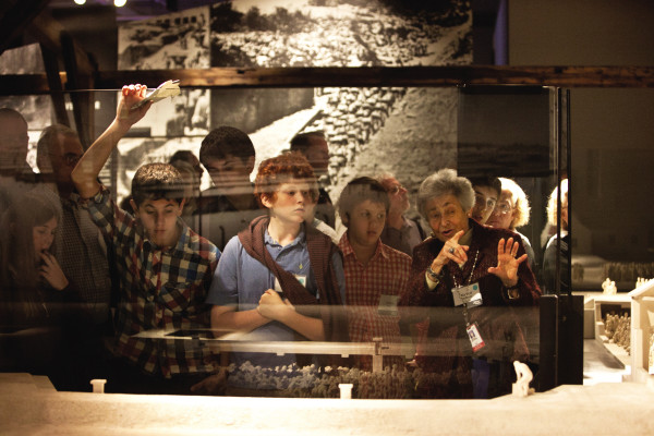 Holocaust survivor and Museum volunteer Margit Meissner leads young visitors from Chicago on a tour of the Permanent Exhibition during the 2011 Grandparents Trip. US Holocaust Memorial Museum