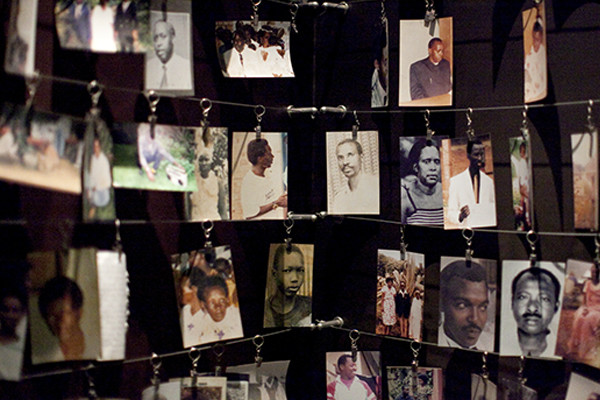 Photographs of people killed in the Rwandan genocide hang in the Kigali Genocide Memorial Museum. <i>Laura Elizabeth Pohl for the US Holocaust Memorial Museum</i>