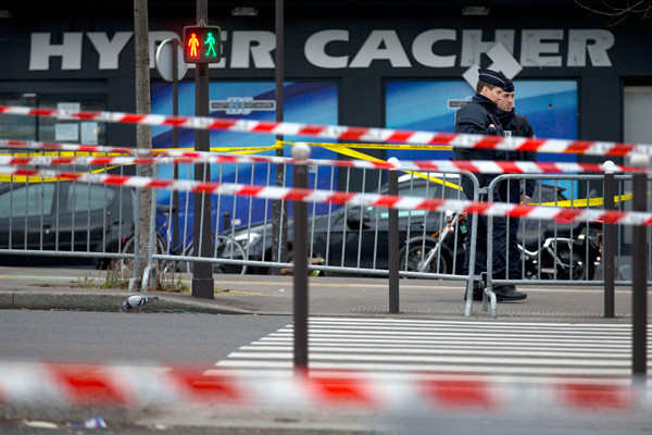 Two police officers stand guard after a January 2015 terrorist attack on a kosher market in Paris, France. <i>Peter Dejong, AP</i>