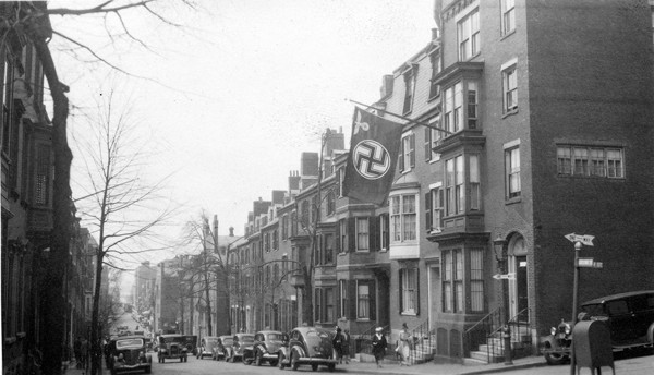 A Nazi flag outside the German consulate's house on Chestnut Street in Beacon Hill, May 1940. <i>Andrew J. Lloyd Company, courtesy of the Bostonian Society</i>