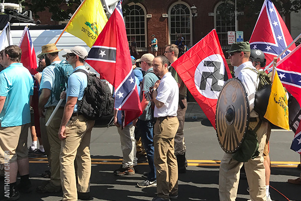 Unite the Right rally attendees prepare to enter Emancipation Park in Charlottesville, Virginia, on August 12, 2017. <i>Anthony Crider</i>