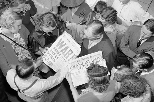 People look at Washington, DC, newspapers on September 1, 1939—the day Nazi Germany invaded Poland, starting World War II. <i>Harris & Ewing Collection/Library of Congress</i>