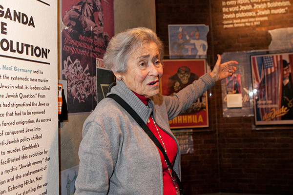 Margit Meissner, Holocaust survivor and Museum volunteer, guides a tour of <i>State of Deception: The Power of Nazi Propaganda</i> in Washington, DC. <i>US Holocaust Memorial Museum</i>