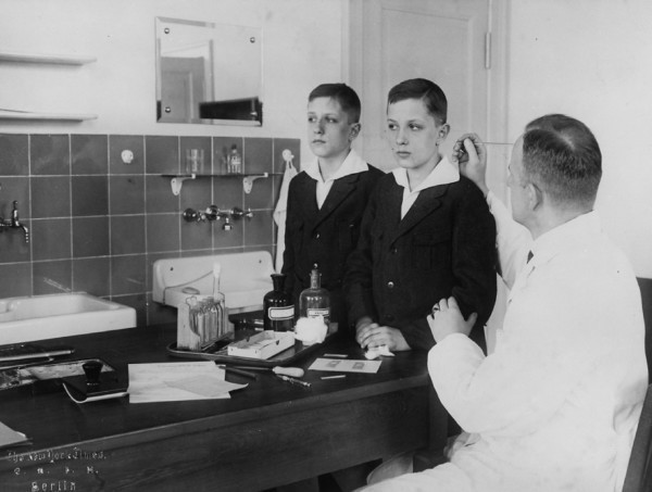 As the head of the Kaiser Wilhelm Institute's Department for Human Heredity, Dr. Otmar von Verschuer, a physician and geneticist, examined hundreds of pairs of twins to study whether criminality, feeble-mindedness, tuberculosis, and cancer were inheritable. <i>Archiv zur Geschichte der Max-Planck--Gesellschaft, Berlin-Dahlem</i>