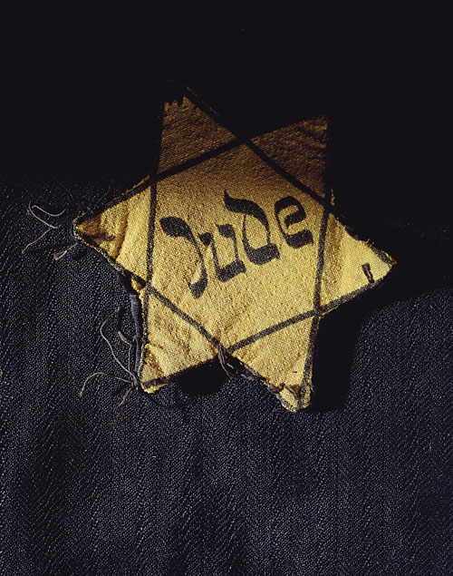 Yellow star of david badge bearing the german word jude jew